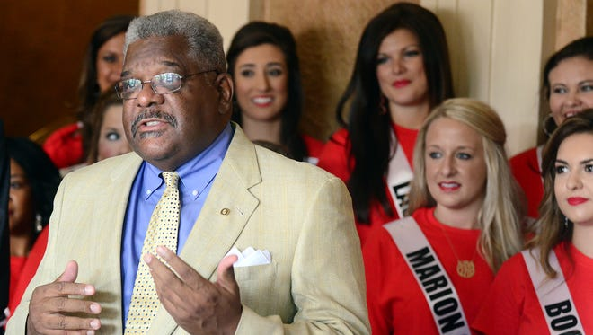 Eddie Holloway, dean of students at the University of Southern Mississippi, welcomes Miss Hospitality Pageant contestants Monday at the Saenger Theater.
