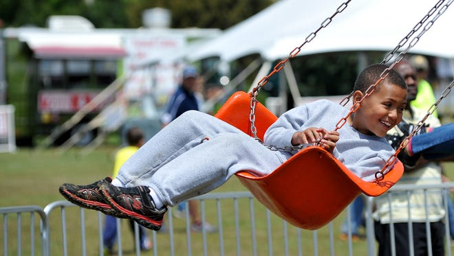 Aidan Guilfoyle, 7, rides the Vortex Sunday during KidFest!