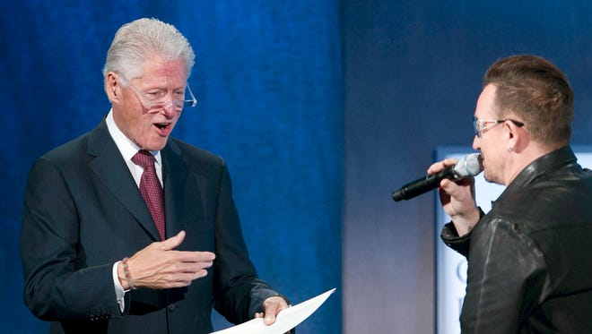 Former President Bill Clinton walks on the stage at the Clinton Global Initiative, moments after Bono on Sept. 24, 2013 in New York.