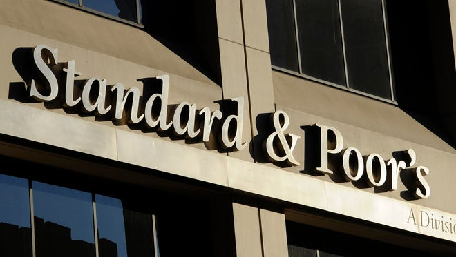 This Oct. 9, 2011 file photo shows 55 Water Street, home of Standard & Poor's, in New York. On Wednesday, Oct. 9, 2013, New Jersey filed suit against the bond-rating company becoming the 19th state to claim that S&P defrauded the public.