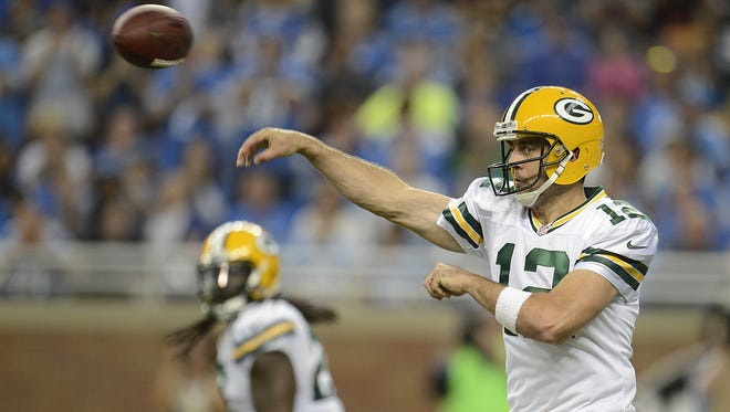 Green Bay Packers quarterback Aaron Rodgers makes a pass during Sunday's game against the Detroit Lions at Ford Field in Detroit. Evan Siegle/Press-Gazette Media/@PGevansiegle