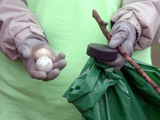 Golf balls, hockey pucks and sticks were among the many items found along the roadways in the Old Homestead subdivision.