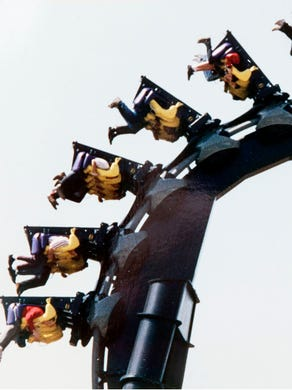1993: Riders are upside down and inverted as they travel around a loop on the Batman ride.
