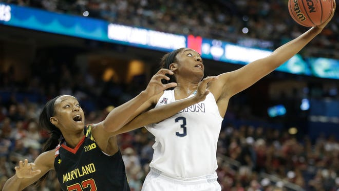 Connecticut forward Morgan Tuck (3) and Maryland guard Shatori Walker-Kimbrough (32) vie for a loose ball during the first half of the NCAA Women's Final Four tournament college basketball semifinal game, Sunday in Tampa, Florida.