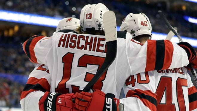 New Jersey Devils center Nico Hischier (13) celebrates his goal against the Tampa Bay Lightning with right wing Michael Grabner (40) during the first period of Game 2 of an NHL first-round hockey playoff series Saturday, April 14, 2018, in Tampa, Fla.