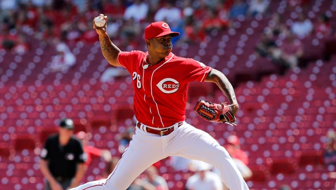 Cincinnati Reds relief pitcher Raisel Iglesias (26) delivers a pitch in the 10th inning of the MLB National League game between the Cincinnati Reds and the Colorado Rockies at Great American Ball Park in downtown Cincinnati on Thursday, June 7, 2018. The Reds won the final game of the series, 7-5, on a walk-off home run by Winker in the 13th inning.