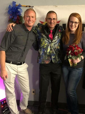 Erin Kelley and Travis Mueller were announced at the Wedding Wish contest winners at the Bridal Faire 2018 at the Holiday Inn Conference Center in Fond du Lac.  Pictured are Mueller, left, and Kelley, right, with Terry Davis, middle.