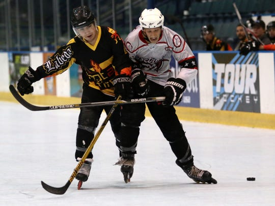 A Hot As Fire and Detroit Stars player fight for possession