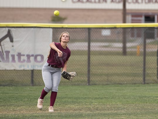 Calallen's Jessica Johnson fields a ball during practice