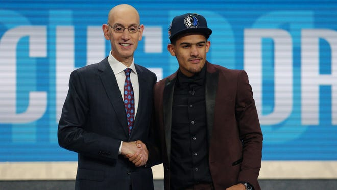 Trae Young stands with Adam Silver after being selected with the No. 5 overall pick.