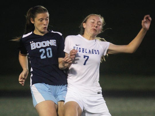 Boone County's Savannah Briedis, left, and Highlands' Lauren Deckert battle for the ball during Highlands 3-0 win over Boone County in girls soccer Sept. 28, 2017 at Tower Park in Fort Thomas.