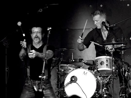 Musicians Jesse Hughes (L) and Josh Homme of Eagles