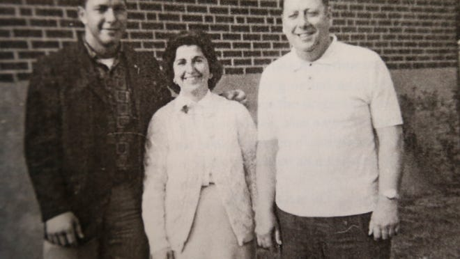 Tom Huebner, left, with his parents, Helen and Joe Huebner, in a family photo. She was killed in a Delhi Township bank robbery in 1969.