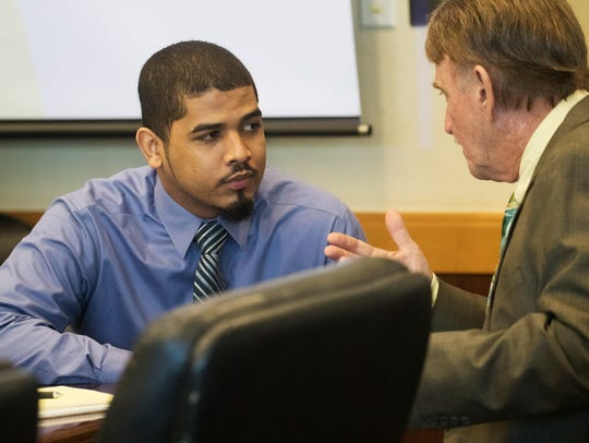 Brian Hyde confers with his attorney during his trial