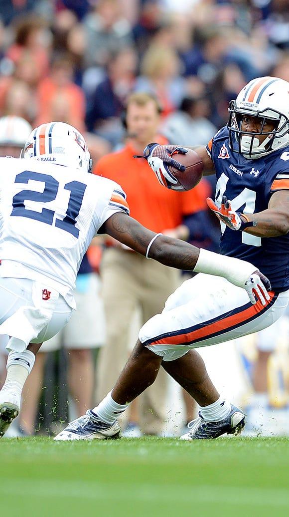 Auburn defensive back Mackenro Alexander (left) is