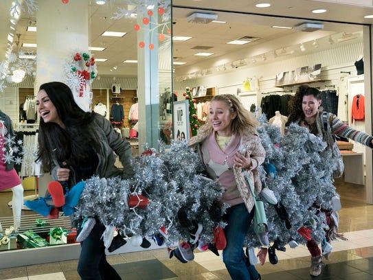 Mila Kunis, left, Kristen Bell and Kathryn Hahn go