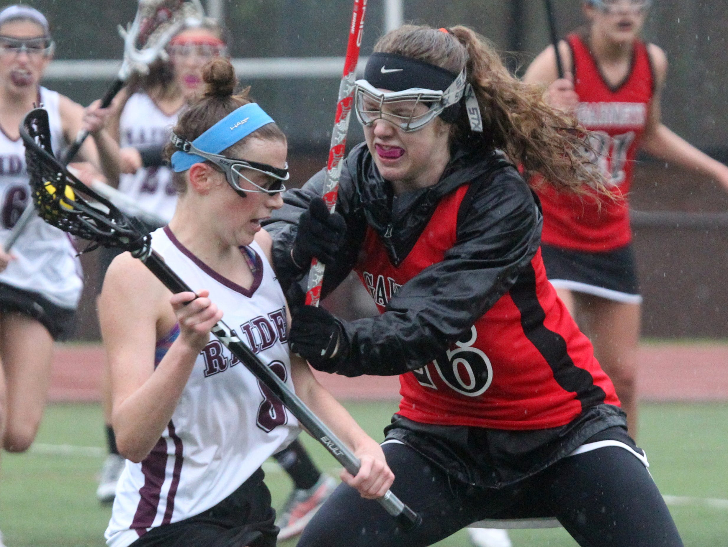 Rye's Caroline Neave pressures Scarsdale's Jilly Mehlman during their game at Scarsdale May 13, 2016.