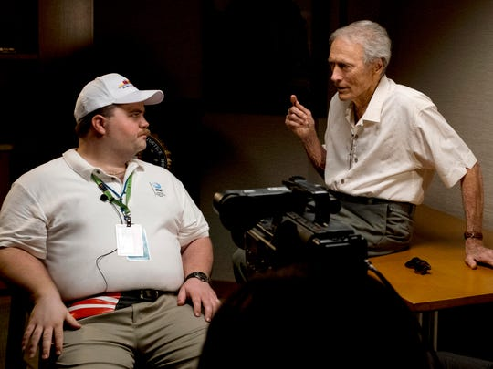 "Director Clint Eastwood speaks with actor Paul Walter Hauser during the filming of ""Richard Jewell."""