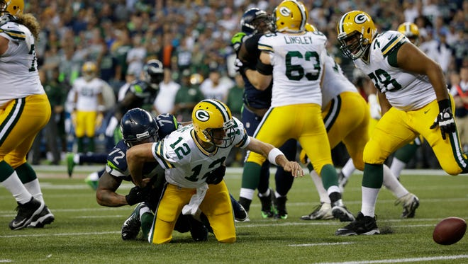 Packers quarterback Aaron Rodgers fumbles after being sacked by Seahawks defensive end Michael Bennett, who beat Derek Sherrod (78) on the play. Sherrod later recovered the fumble in the end zone for a safety.