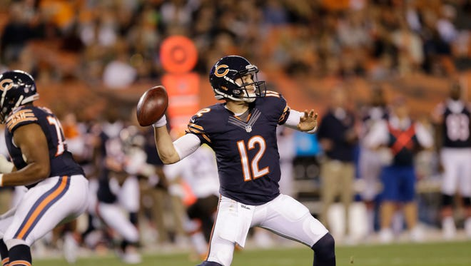 Chicago Bears quarterback David Fales passes against the Cleveland Browns in the first quarter of a preseason NFL football game Thursday, Aug. 28, 2014, in Cleveland. (AP Photo/Tony Dejak)