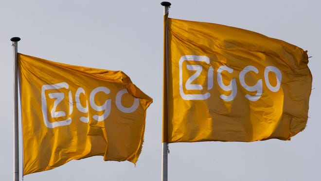 The company logo flies on the headquarters of Dutch cable and broadband provider Ziggo in Utrecht, Netherlands.