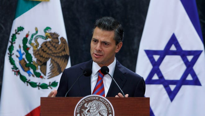 Mexico's President Enrique Pena Nieto speaks during an agreement signing ceremony with Israeli President Shimon Peres during a signing ceremony at Los Pinos presidential residence in Mexico City, on Nov. 27, 2013.