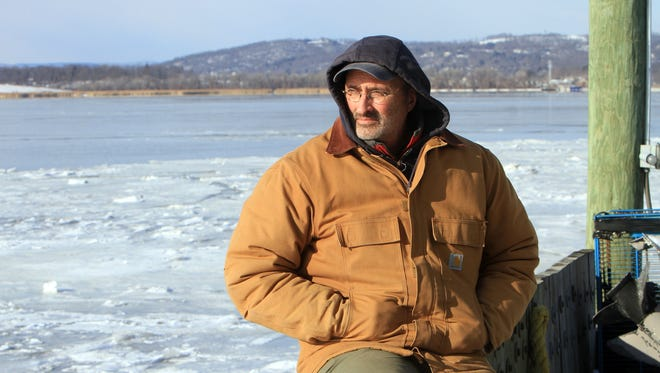 Riverkeeper boat captain John Lipscomb talks about crude oil shipments on the Hudson River, while sitting along the Hudson in Ossining Jan. 23.