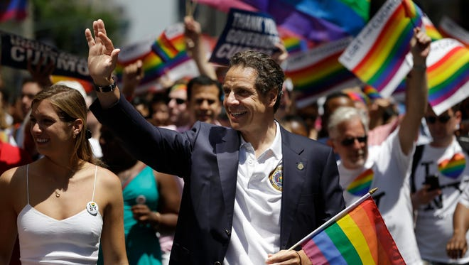 New York Gov. Andrew Cuomo marches in the Gay Pride Parade in New York on Sunday. Fifth Avenue became one big rainbow as thousands of participants waving multicolored flags made their way down the street for New York City's annual Gay Pride march.