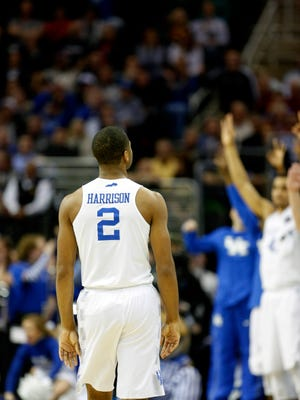 Kentucky's Aaron Harrison listens to the crowd erupt after he knocks down a three to give the Cats the lead. March 28, 2015