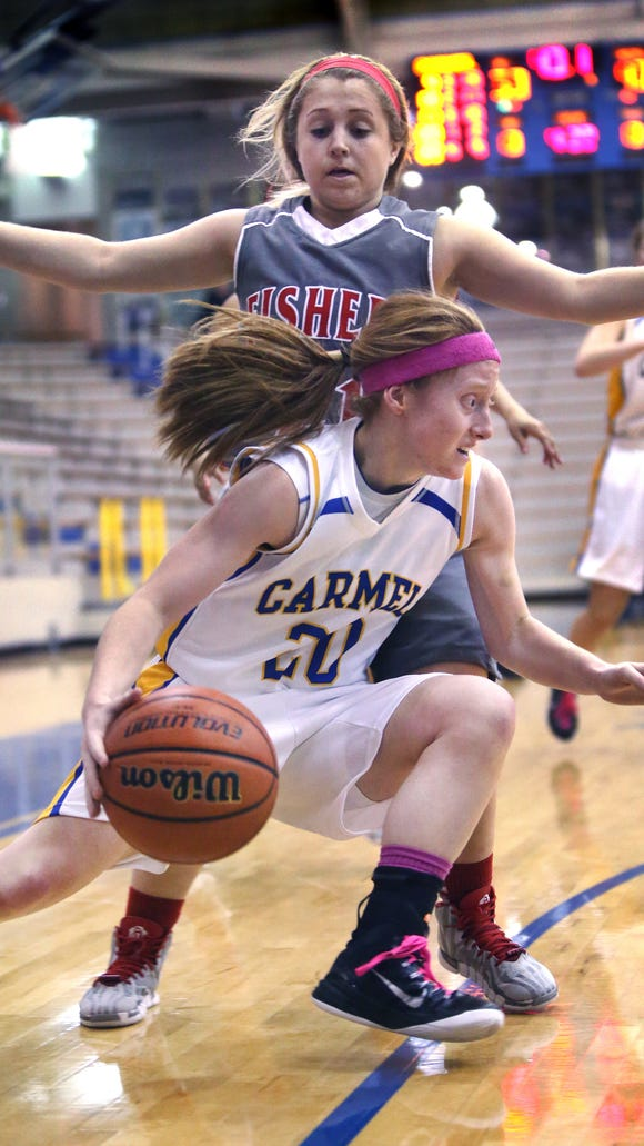 Carmel Lady Greyhound Abby Abel drives past Fishers Lady Tiger Brooke Sugg in the fourth quarter of the Lady Greyhounds' 55-43 home win on Tuesday, Jan. 20, 2015.