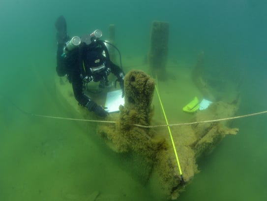 A diver surveys the La Salle shipwreck near Point Beach