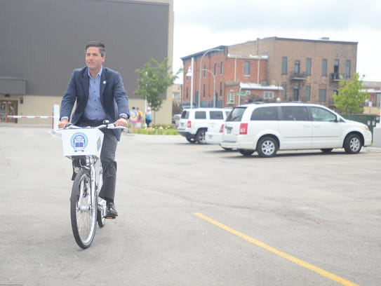 City Manager James Freed takes the first official ride