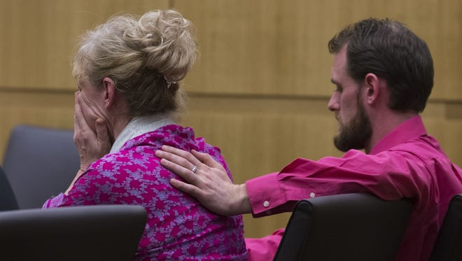 Tracy Elise reacts as the guilty verdicts are read in court while her son, Ben Wade, comforts her.