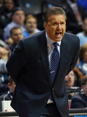Dec 19, 2015; Brooklyn, NY, USA; Kentucky Wildcats head coach John Calipari reacts during the second half against the Ohio State Buckeyes at Barclays Center. Ohio State Buckeyes won 74-67. Mandatory Credit: Anthony Gruppuso-USA TODAY Sports