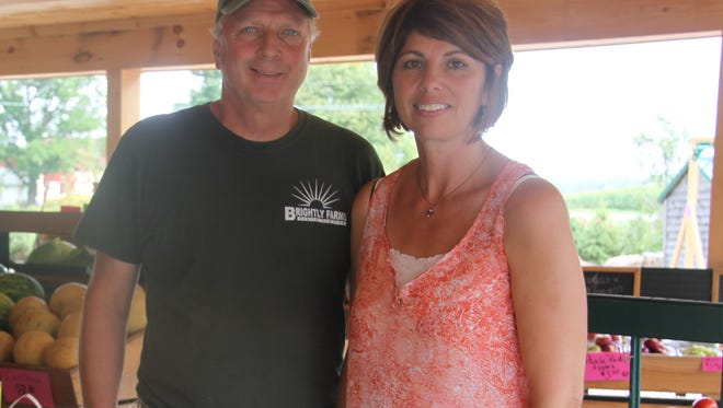 Dean and Betsy Brightly in front of their newly opened farm market and bakery at 525 Drake Road in Hamlin.