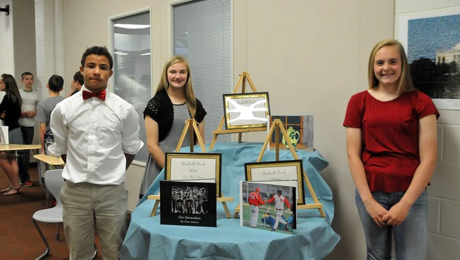 """Port Clinton Middle School Fleet 8 students Chaz Jackson, Madelynne Schurdell and Marie Gluth were recognized for their work on original stories published during the grade's """"Build-a-Book"""" fair on Thursday."""