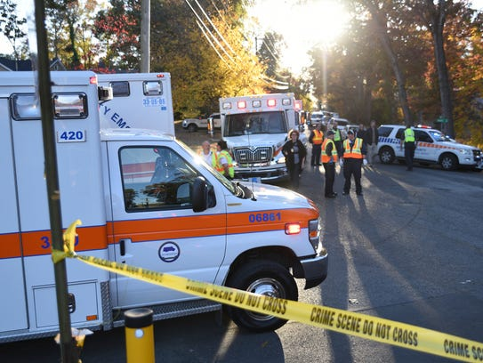 Emergency personnel work the scene of a fatal elementary