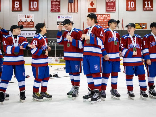 The New Jersey Colonials were given medals and hats