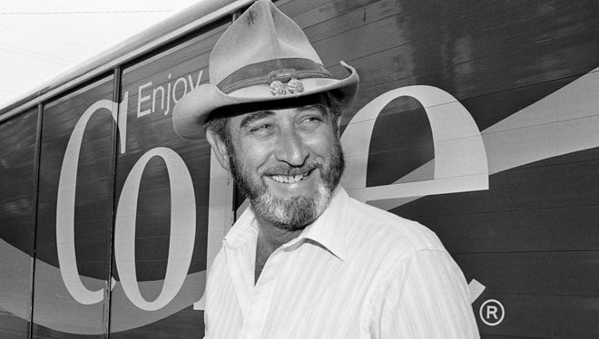 """Country music artist Don Williams is all smiles that they have brought back his favorite beverage, the new/old """"Coca-Cola Classic"""" after getting one of the first two cases of it in Nashville during a press conference on Music Row July 30, 1985."""