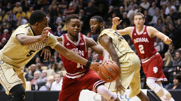 Hoosiers guard Yogi Ferrell battles Purdue forward Basil Smotherman, January 28, 2015.