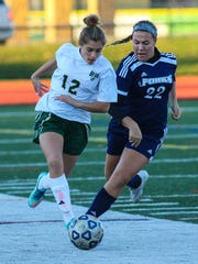 Vestal's Victoria McKnight  and Chenango Forks' Anastasia Rusnak battle for the ball during a 2015 game.