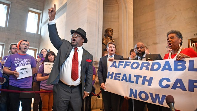 Rep. Antonio Parkinson, D-Memphis, joins with protesters in calling for health care legislation Tuesday, Jan. 9, 2018, in Nashville.