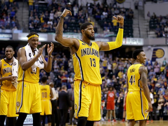 "Indiana Pacers forward Paul George (13) and his teammates welcomes the fan's chanting ""Lance Stephenson"" late in the second half of their game Tuesday, April 4, 2016, evening at Bankers Life Fieldhouse. The Indiana Pacers defeated the Toronto Raptors 108-90."