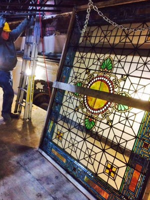 One of the panels of the Rudy Brothers glass ceiling is removed for restoration.  The beautiful stained glass ceiling was uncovered by Point Park University while renovating a former bank and stock exchange building as part of its new theater complex.