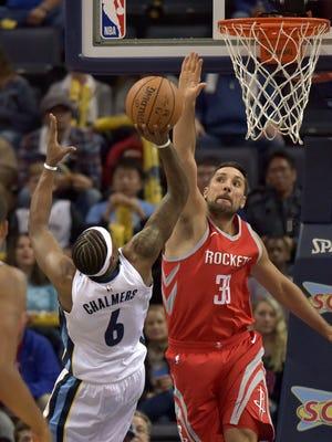 Memphis Grizzlies guard Mario Chalmers (6) shoots against Houston Rockets forward Ryan Anderson (33) during the first half of an NBA basketball game Saturday, Nov. 18, 2017, in Memphis, Tenn. (AP Photo/Brandon Dill)