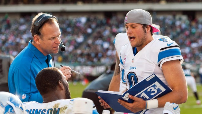 Oct 14, 2012; Philadelphia, PA, USA; Detroit Lions quarterback Matthew Stafford (9) talks with offensive coordinator Scott Linehan and wide receiver Calvin Johnson (81) along the sidelines during the fourth quarter against the Philadelphia Eagles at Lincoln Financial Field. The Lions defeated the Eagles 26-23 in overtime. Mandatory Credit: Howard Smith-USA TODAY Sports