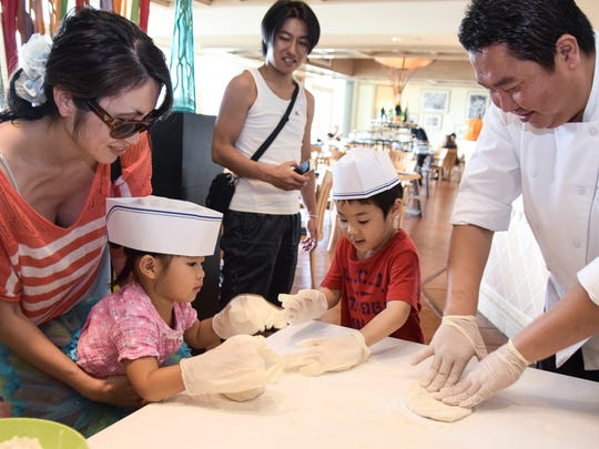 Executive Sous Chef Sean Jung, right, helps Shota Isshiki, 5, and Honoka Kikuchi, 2, knead their own pizza dough at Prego in the Westin Resort Guam on Oct. 31.