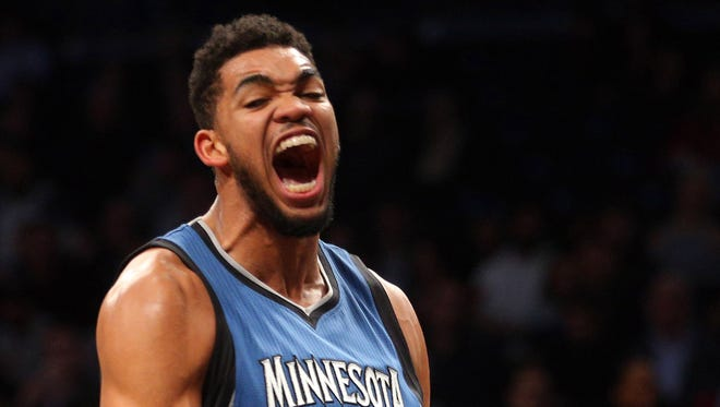 Karl-Anthony Towns (32) reacts after dunking over Brooklyn Nets center Brook Lopez during the second quarter at Barclays Center.