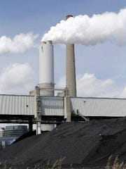 The DTE Energy Co. Power Plant in Monroe, Michigan is the first coal-fired power plant in Michigan to use scrubbers , which reduce sulfur dioxide emissions by about 97 percent, according to a company press release.