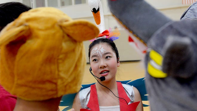 "Yining Zhu talks to judges about her costume after their performance Thursday, May 21, 2015 during the ""Runaway Train"" event at the Odyssey of the Mind World Finals at Michigan State University. The team is from Yuepu Experimental School in Shanghai, China."